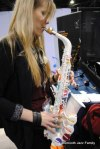 Shannon Kennedy playing with a plastic saxophone